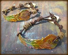 Brass Peacock Feather and Knotted Leather Bracelet by SnowPineDesign on Etsy