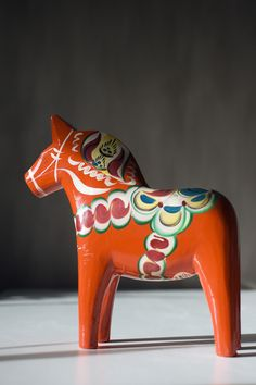 Dalahästen is the most bought Swedish souvenir. It is a stylized wooden horse most commonly found in red with a typical folk art decoration called kurbits. Dalahästen has been made since the 1600's in Dalarna and is still today mainly manufactured in a village called Nunäs outside of Mora in Dalarna.  Photo taken by: Cecilia Larsson