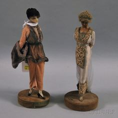 * Two Lafitte-Desirat Wax Fashion Dolls, France, c. 1911-1913, a figure with molded wax head and pink velvet gown with net and faux fur-trimmed overlay and faux fur muff and hat, covered base signed Lafitte-Desirat and fitted with gold-tone plaque marked and dated AUX COURSES (1913); another figure with molded wax head, neck, and chest with purple silk and lace gown with metallic embroidery and metallic purse and headband,