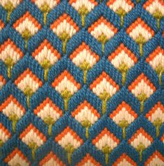 This is a great little bargello needlepoint pillow. Colors in teal, orange, light pink and lime green. Back of pillow made in small wale corduroy