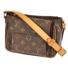 LOUIS VUITTON Pochette Viva Cite Monogram Canvas Leather M51165 Brown Cross Body Bag. Get the trendiest Cross Body Bag of the season! The LOUIS VUITTON Pochette Viva Cite Monogram Canvas Leather M51165 Brown Cross Body Bag is a top 10 member favorite on Tradesy. Save on yours before they are sold out!