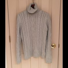 """Ralph Lauren Sweater Grey sweater with silver metallic thread detail. SO cozy and warm!  Loose feel slightly long sleeve for bunching. Turtleneck style fits comfortably. Slouchy is u like!  Fits long depending on height. I'm 5'4"""", fell to top of leg. No tags. Never ever wore. Pair with jeans, leggings, the perfect vest...high Ralph quality. No trades. Ralph Lauren Sweaters Cowl & Turtlenecks"""