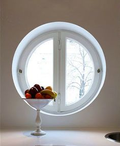 Fruit bowl as art in the kitchen. Round window.