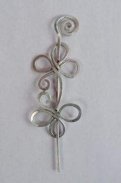 Hand-crafted Celtic hair pin in a Celtic knot style, with a flower blossom motif.
