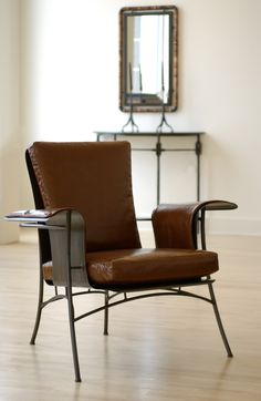 Club Chair in hand-formed steel finished with bronzy patina. Upholstered in leather. #evanlewisinc #evanlewissculptor #clubchair #handmadefurniture