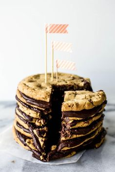 This piled-high party treat goes (way) above and beyond the chocolate-chip cookie cakes of our youth.