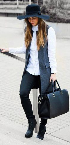 Vest, hat and a soft look. More inspo at www.closertofashion.com