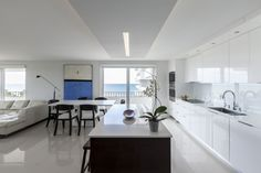 This clean white kitchen with striking black accents was completed by Leandro Mora Designs. White Contemporary Kitchen, Interior Design Magazine, Decoration, Dining Table, House Design, Luxury, Kitchens, Black Accents, Argos