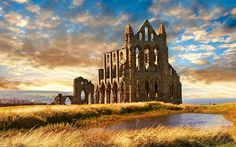 Bram Stoker, author of Dracula, was inspired by Whitby Abbey's gothic splendour. The creature arrived on a boat into Whitby. Yorkshire England, North Yorkshire, Whitby England, Dracula, Pictures Of England, Tour Of Britain, Whitby Abbey, Wanderlust Travel, Amazing