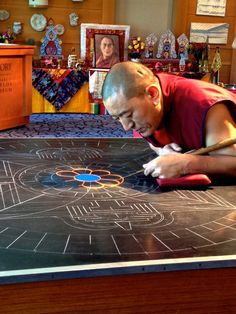 Construction of the sand mandala has begun.. The Emory-Tibet Partnership. March 2013