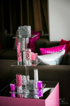 Creative candy centerpiece in the lounge at a Modern Pink Bat Mitzvah {Photo by Michael Jurick Photography}