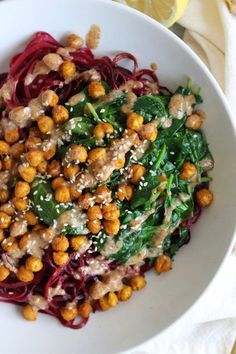 Beet Noodle Bowls with Turmeric Roasted Chickpeas, Spinach, and Ginger Almond Butter Dressing