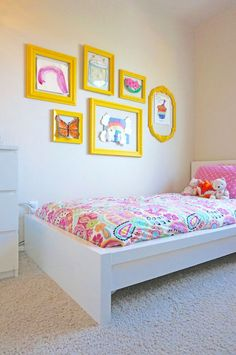 Make your tiny tot's room into her own art gallery.