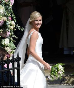 Classic: Ali had chosen a high front dress which scooped down at the back, while she wore ...