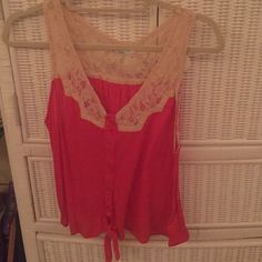 Pink Laced Urban Outfitters Tank Top Very soft tank top with butted down with a tie at the bottom. Cream colored lace at the top. Large but fits like a medium. Urban Outfitters Tops Tank Tops
