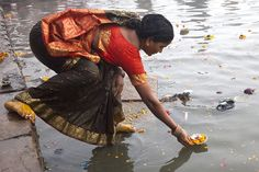 Ritual in Hinduism known as 'deep daan'. The offering of light or flame to the holy river Ganges to receive blessings. The flame denotes 'purity.