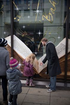 Onlookers enjoying the Coutts Christmas windows while install takes place.  Realised by JUSTSO Ltd.