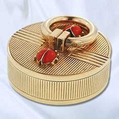 Cartier Ladybug Pillbox. 9K Yellow gold round Cartier pillbox with two little enameled ladybugs on the top, London, 1954. This pillbox measures 1 1/4 round and 1/2 tall.