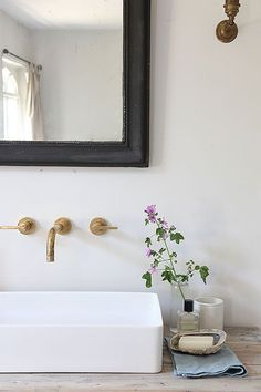 Cottage bathroom features a reclaimed wood vanity topped with a rectangular vessel sink under an aged brass faucet and a black beveled mirror. Bathroom Renos, Laundry In Bathroom, Bathroom Faucets, Bathroom Interior, Bathroom Black, Bathroom Ideas, Bathroom Inspo, Hipster Bathroom, Top Mount Bathroom Sink