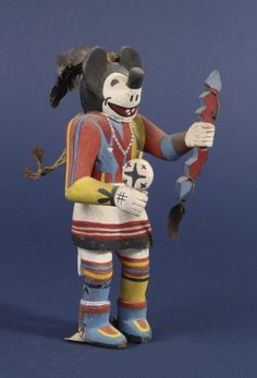 """Mickey Mouse kachina doll   Ht. 8""""  c. 1960  Hopi, Hopi Pueblo,  Otis Dozier Collection, Dallas  When Disney memorabilia became collectible, objects like this Mickey doll became sought after by collectors. As a consequence these dolls have become quite rare on the market."""