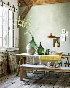 a dining space with wabi sabi aesthetics, a wooden dining set, concrete wlals and a rough wooden floor plus vases Wabi Sabi, Tuscan Dining Rooms, Wooden Dining Set, Vibeke Design, Rustic Home Design, Tuscan Decorating, Decorating Ideas, Modern Rustic, Interior Inspiration