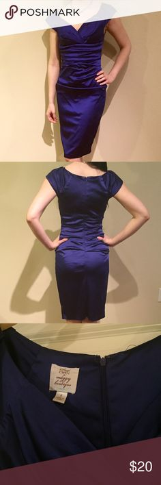 Purple-Blue Dress Worn twice to two different wedding ceremonies. Pretty classy. Minor scratch and spot by the zipper on the back - not noticeable at ALL. Dresses Midi