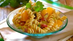A spicy pasta salad with a tangy peach and spring onion dressing!