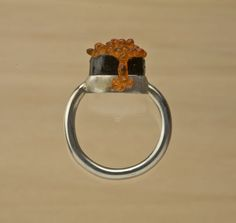 2.5 x 2 x 1 cm    Made with reclaimed and recycled Japanese gumball machine toys known as gashapon, this cast ring is decoratively set with plastic ikura (salmon roe), which drips over the edge. Shown in sterling silver. Available in sizes 4 through