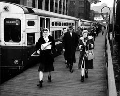 "On a late winter Thursday in 1962, 'L' riders exit a Loop-bound Ravenswood ""B"" train at Chicago. Today, this would be a Brown Line train."