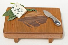 Betta cutting board https://www.etsy.com/listing/167066177/cutting-board-footed-serving-tray-with