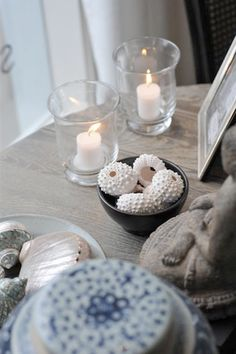 bowls of shells with frames and candles
