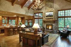 This massive vaulted room features a large stone fireplace at one end and a formal dining area at the other.   Plan # 441015.