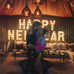 Miley Cyrus and Liam Hemsworth Ring in the New Year With a Sweet Kiss from InStyle.com