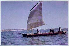 Dugout canoe under sail near Luanda , Angola .