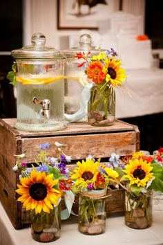 cute rustic wedding centre pieces ideas with sunflowers, mason jars and wooden crates
