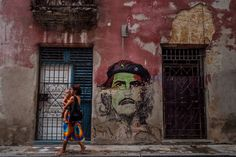 Woman carrying a child in Havana