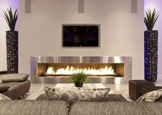 Se você ainda não tem ideia sobre o que fazer em relação a sua sala de estar, que tal montar uma bela lareira, confira algumas fotos aqui!