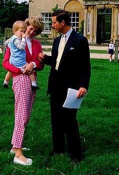 Princess Diana,Prince Charles and Prince Harry with Prince William way in the background.