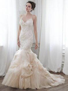 Maggie Sottero plus size fit and flare wedding dress