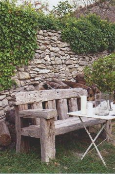 A garden bench constructed from massive beams of antique wood is placed in front of an ivy-clad stone wall Rustic Outdoor Benches, Rustic Bench, Diy Bench, Outdoor Decor, Garden Benches, Rustic Farmhouse, Rustic Furniture, Garden Furniture, Outdoor Furniture Sets