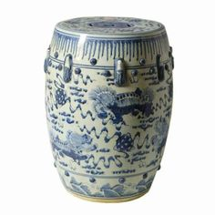 Blue & White Garden Stool with Lion Motif features asian inspired scenery. Intricate brush-strokes offer hand-painted chinoiserie style to this multi-functional piece.