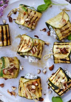Grilled zucchini rolls with creamy spelt pearls and summer herbs