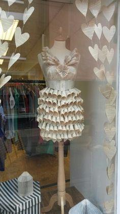 Paper dress in charity shop window