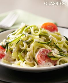 Hop on the zoodles craze and enjoy this simple CLASSICO Zucchini Alfredo recipe made with zucchini cut into spiral noodles. Add halved cherry or grape tomatoes for tasty CLASSICO Zucchini Alfredo. Vegetable Dishes, Vegetable Recipes, Vegetarian Recipes, Cooking Recipes, Healthy Recipes, Vegetarian Dish, Ww Recipes, What's Cooking, Drink Recipes