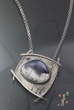 """""""Time Stands Still"""" from Kathleen Krucoff's Treescape collection. Dendritic opal stone set in sterling silver."""