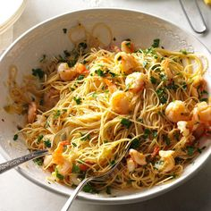Light & Lemony Scampi Recipe -A touch more lemon helped me trim the calories in our favorite shrimp scampi recipe. For those who want to indulge, pass around the Parmesan. —Ann Sheehy, Lawrence, Massachusetts