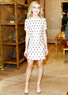 Kiernan Shipka wears a floral matching set by Tory Burch and ankle-strap sandals