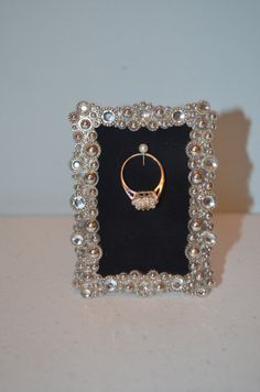 Hey, I found this really awesome Etsy listing at http://www.etsy.com/listing/118376074/engagement-wedding-ring-picture-frame