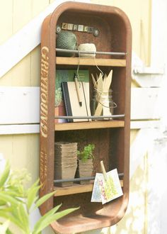 rusty wagon turned into a hanging organizer-Love it!! I will be looking for one at the Flea Market next wk, end!!