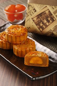 Typical mooncakes are round or rectangular pastries, measuring about 10 cm in diameter and 4–5 cm thick. This is the Cantonese mooncake, eaten in southern China (Guangdong, Hong Kong). A rich thick filling usually made from red bean or lotus seed paste is surrounded by a thin (2–3 mm) crust and may contain yolks from salted duck eggs. Mooncakes are usually eaten in small wedges accompanied by Chinese tea. Today, it is customary for businessmen and families to present them as presents.